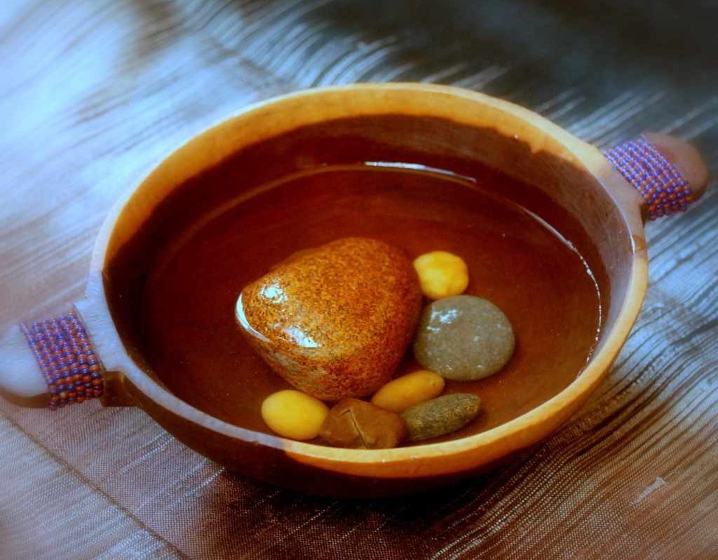 Stones in broth in a soup bowl