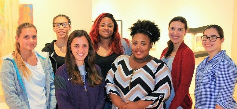 Group of seven young teaching assistants at the Mississippi Museum of Art