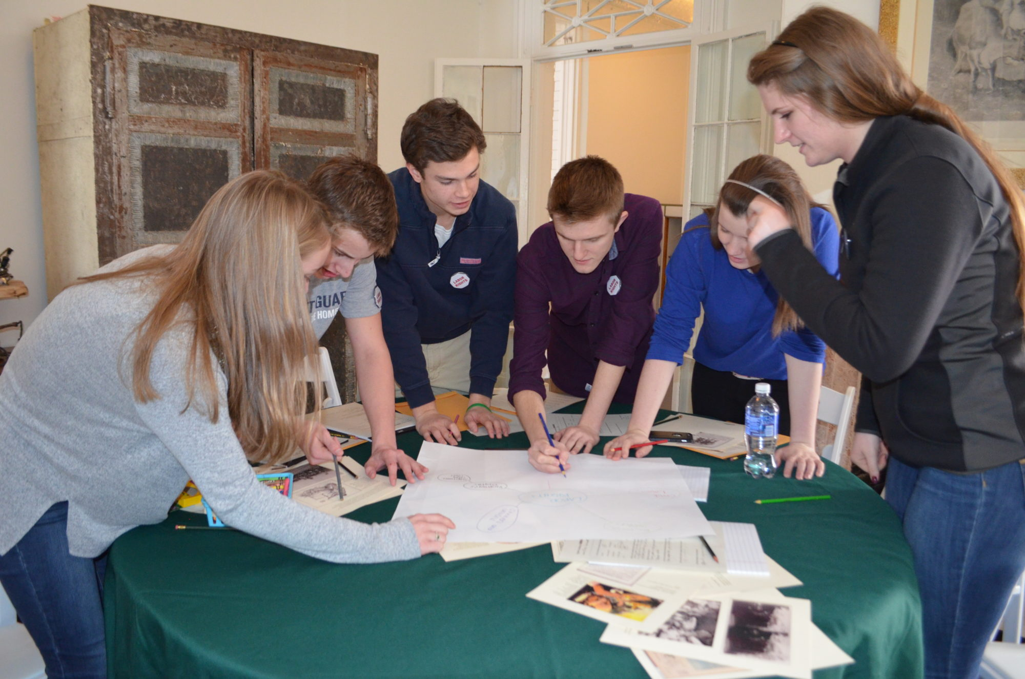 A group of teens around a table playing an Advocacy Game