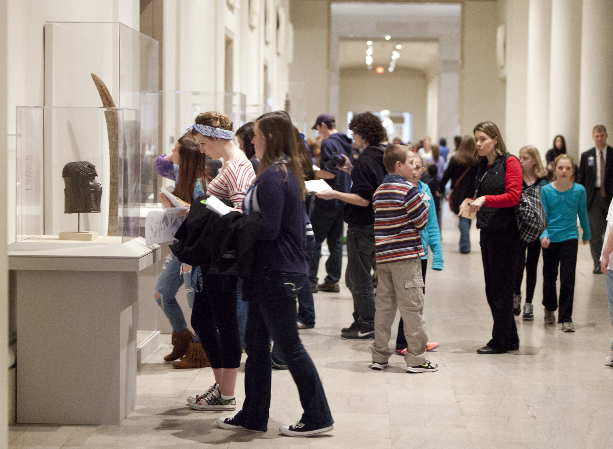 Student visitors to museum in gallery 240; Classical Greece and Rome gallery; temporary installations of African Art