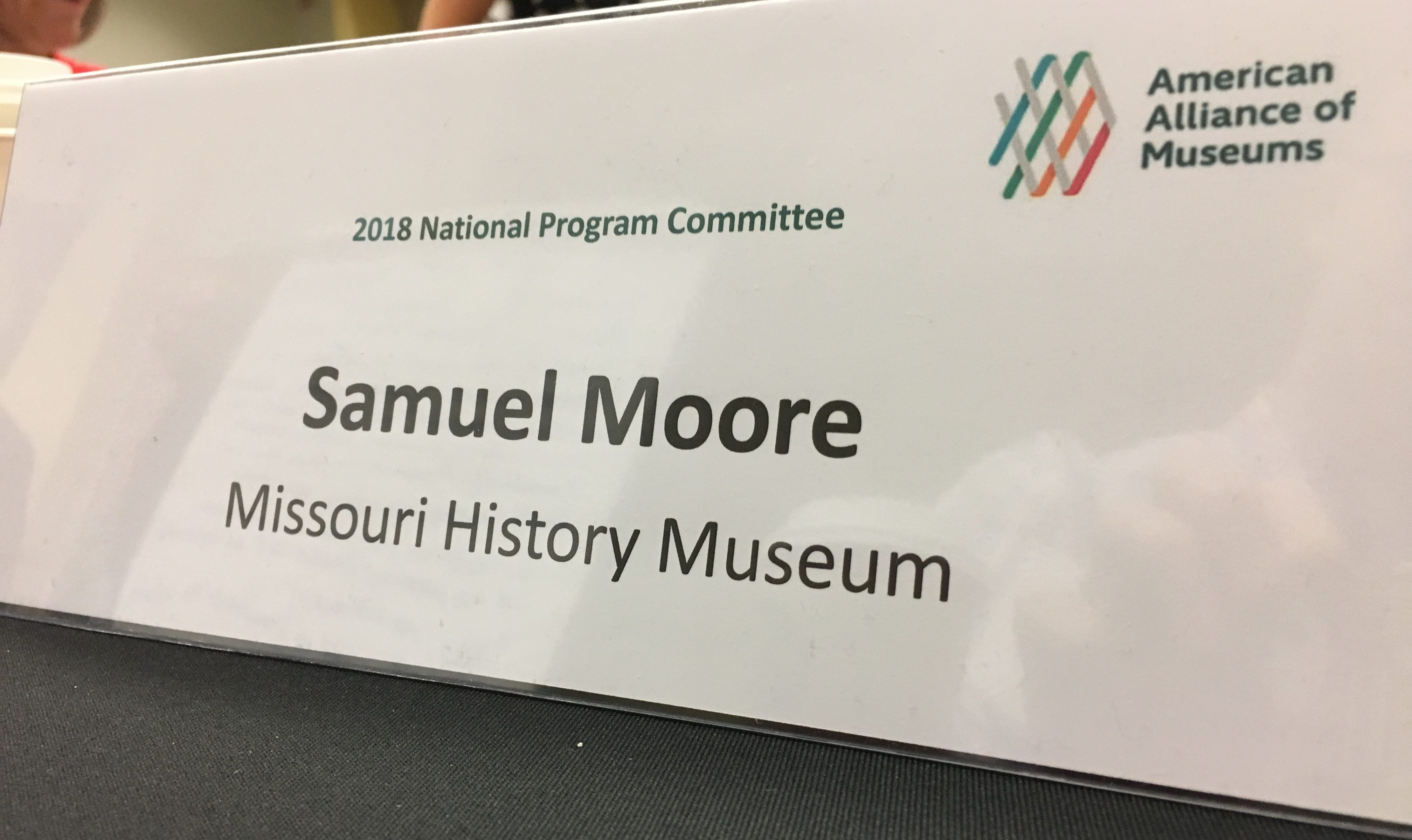 Image of Samuel Moore's name plate at the National Program Committee meeting