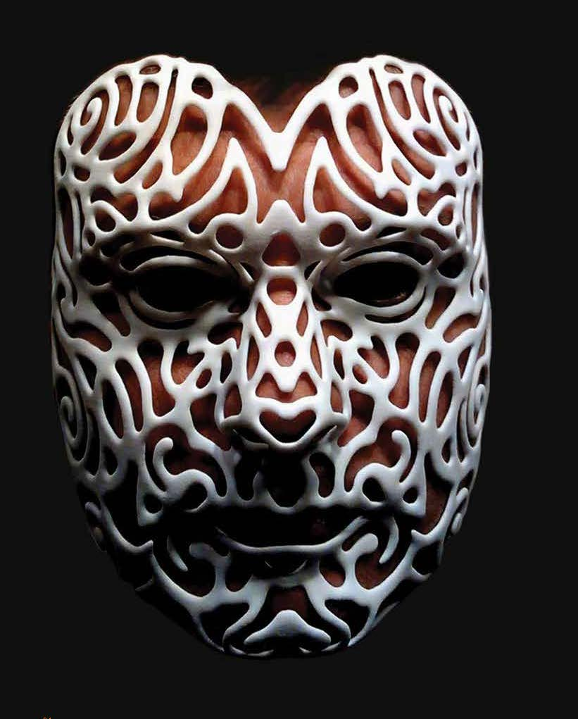 Image of a person's face wearing a 3-D printed mask in white