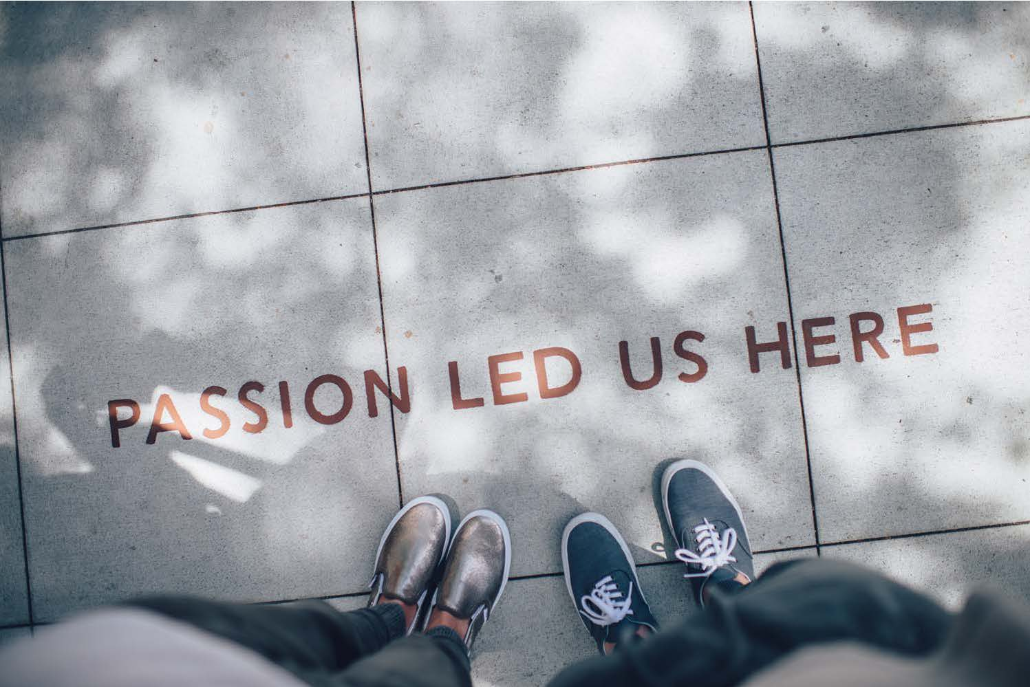 Image looking down at the concrete that says Passion Led Us Here