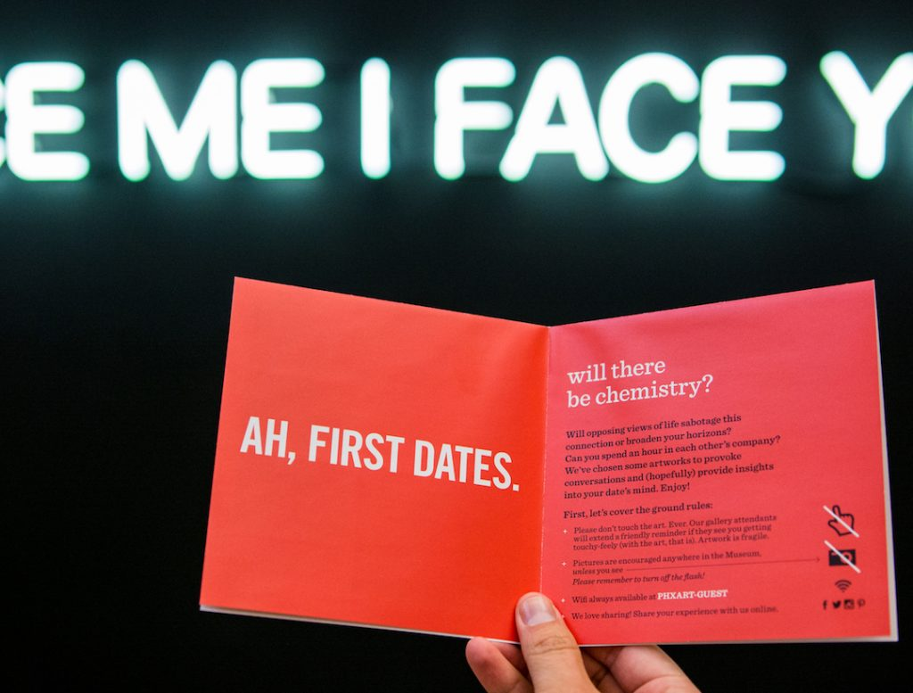 Mi I Face Ah, First Dates written on a card being held by someone