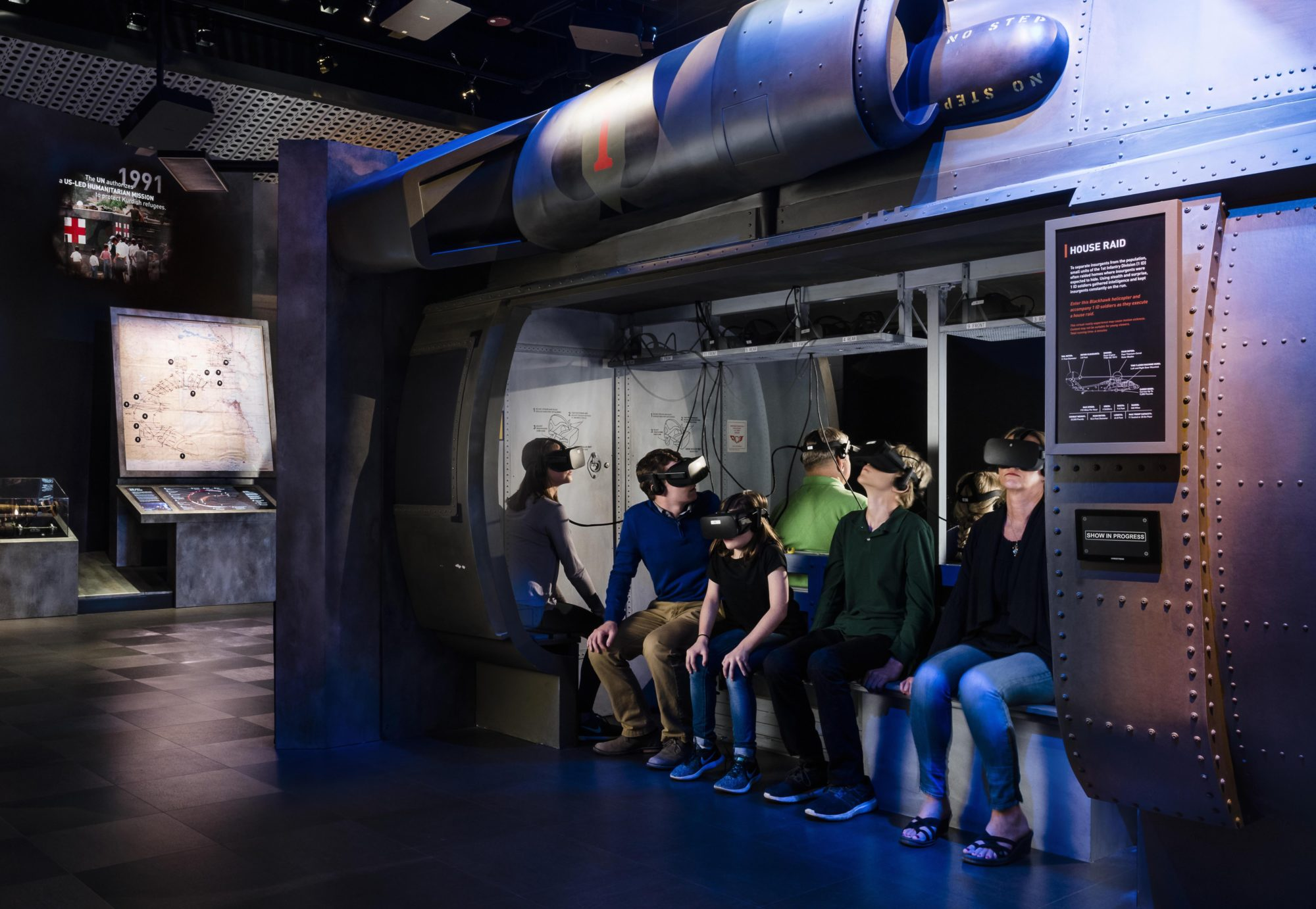 Group of students sitting in a simulator with VR headsets on their heads