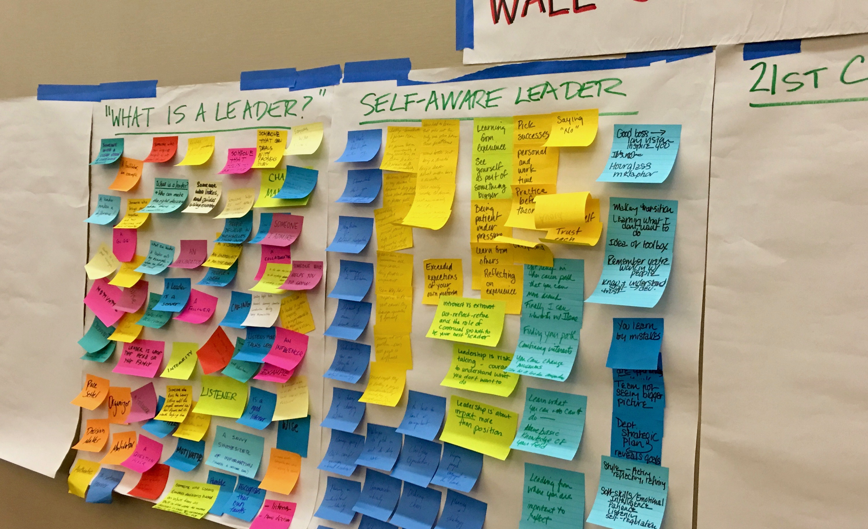 This image shows a large piece of paper with colorful post-it notes attached from a leadership session at AAM's 2017 Annual Meeting. On each note, people have written down different qualities of leadership.