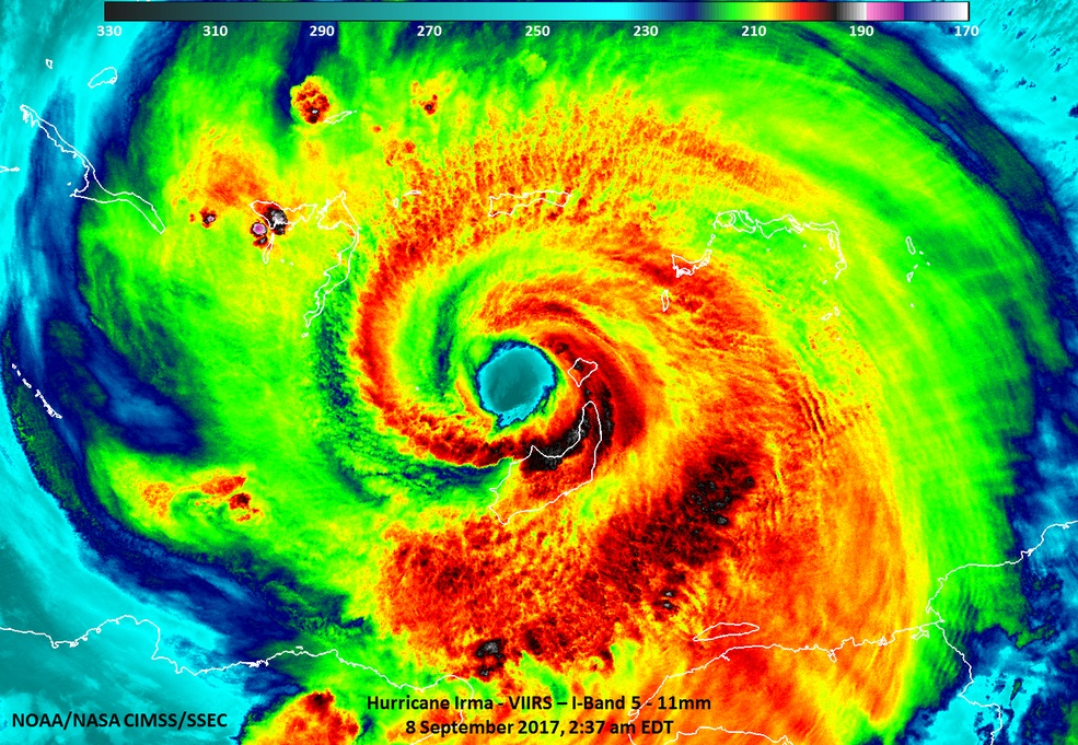 Radar image of a hurricane in bright red, green and blue colors