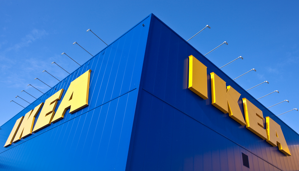 An image of IKEA's blue building with a bright blue sky.
