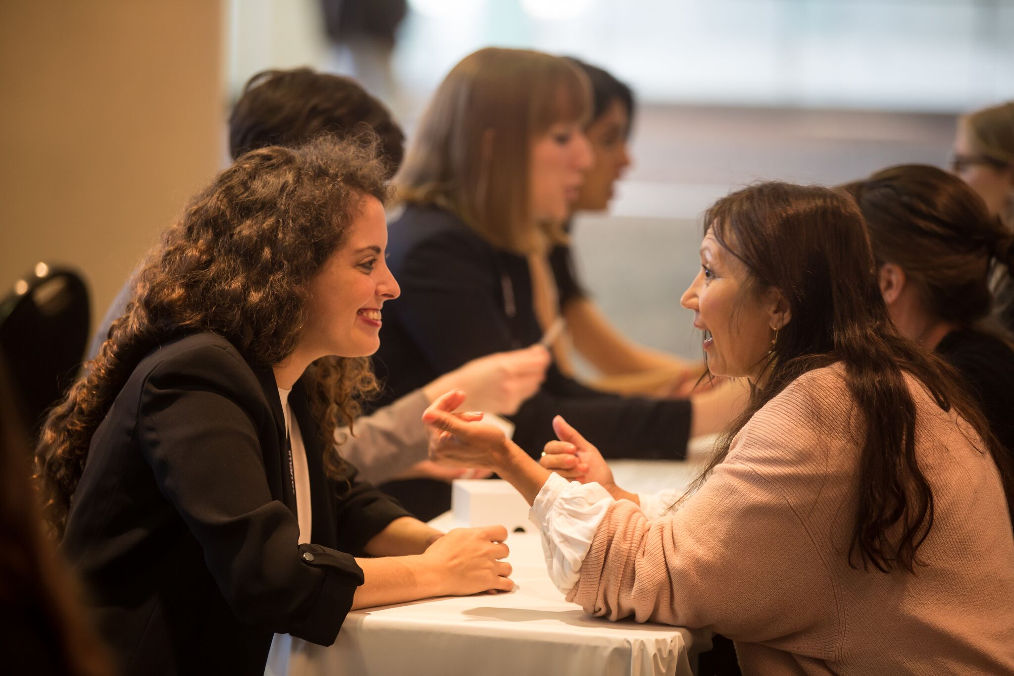 Two women getting to know each other at Speed Networking.