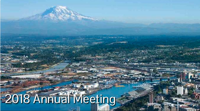 Image: skyline of Tacoma, Washington with mountain in the background and river in the foreground