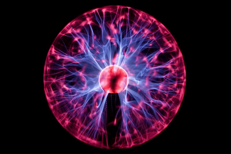 "Image of a plasma globe with red and blue electronic ""arms"" stretching out."