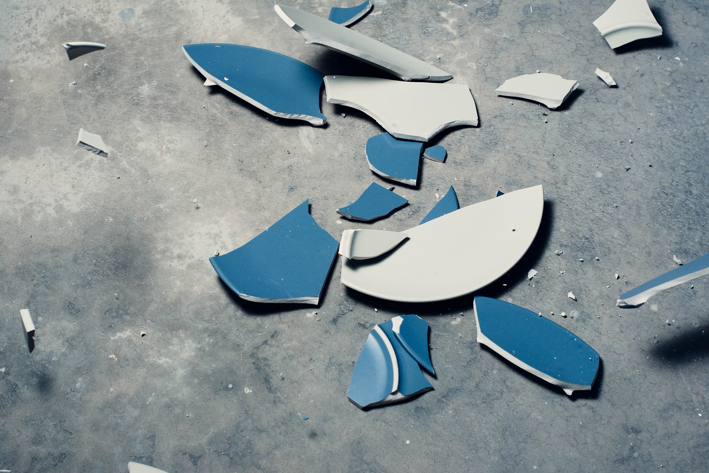 A broken pottery cup.