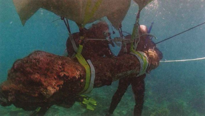 Divers recover a 310-year-old cannon from the Captain Kidd shipwreck.