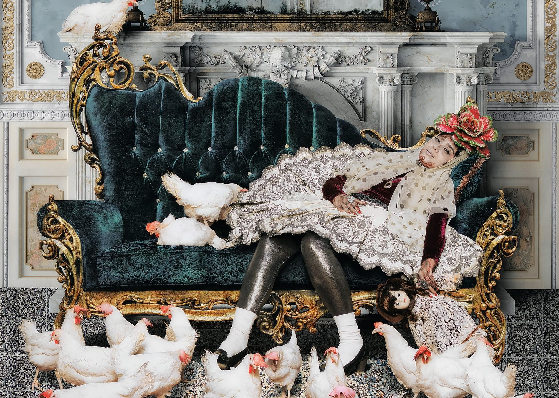 Photograph created by Siamak Filizadeh of a woman reclining on an ornate love seat with chickens pecking the floor in front of her.