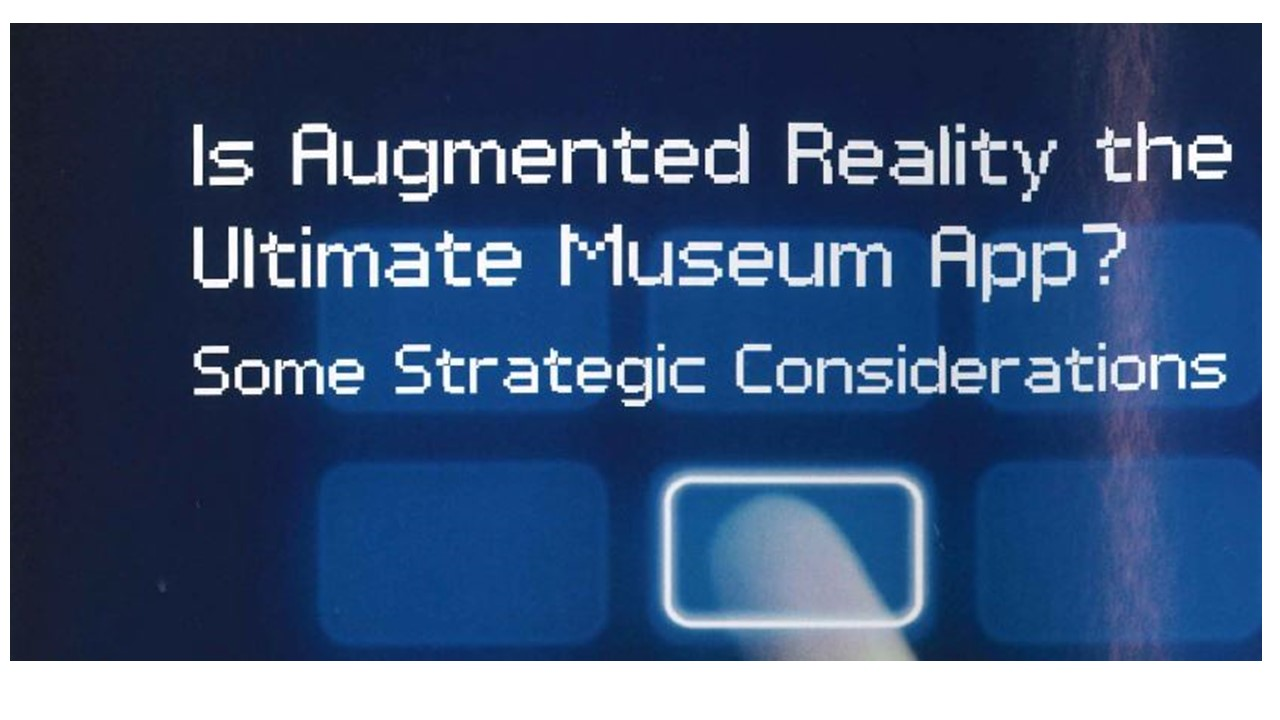 "A blue screen with several opaque rectangles and a person's finger pressed to one rectangle with the words ""Is Augmented Reality the Ulitmate Museum App? Some Strategic Considerations"" at the top of the screen."