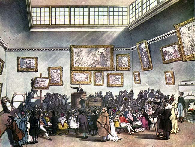 19th century engraving of a live auction, with auctioneer at a podium pointing at a painting and audience standing before him