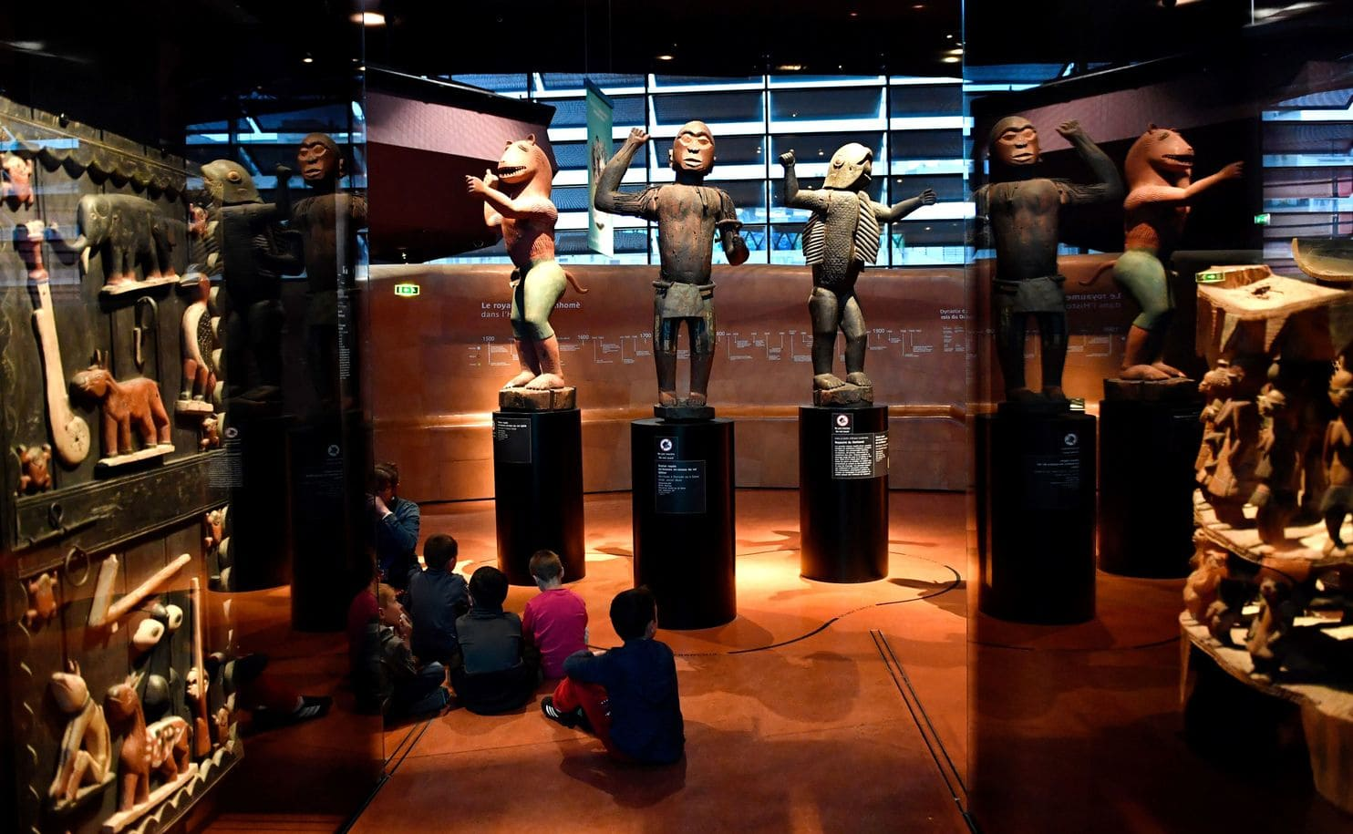 statues and other artifacts from the Kingdom of Dahomey on display at the Musée du Quai Branly in Paris