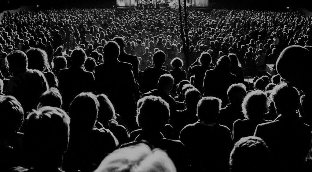 Black and white image of audience at a concert