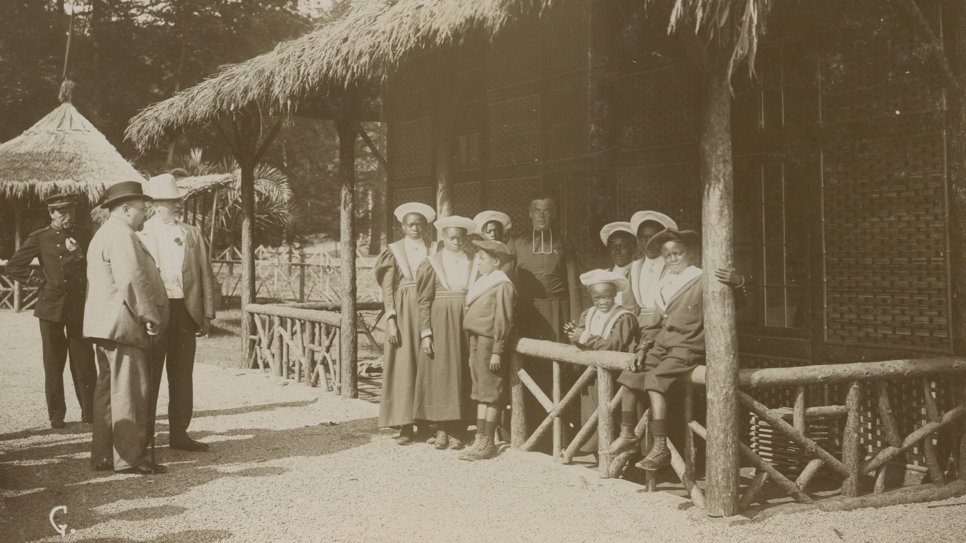 Black and white photo of Belgium mock African village in late 1890s.