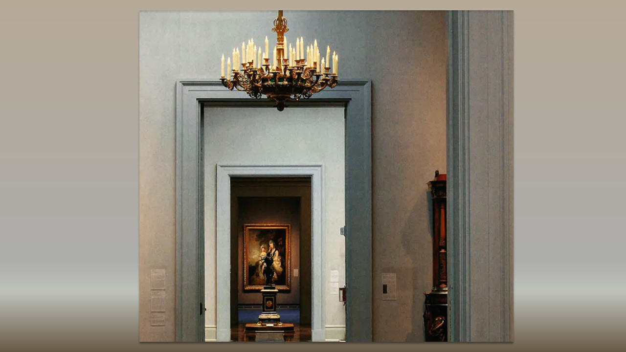 Interior image of the museum's galleries with a candleabra chandelier in the foreground and an oil painting in the far distance through several doorways in view.