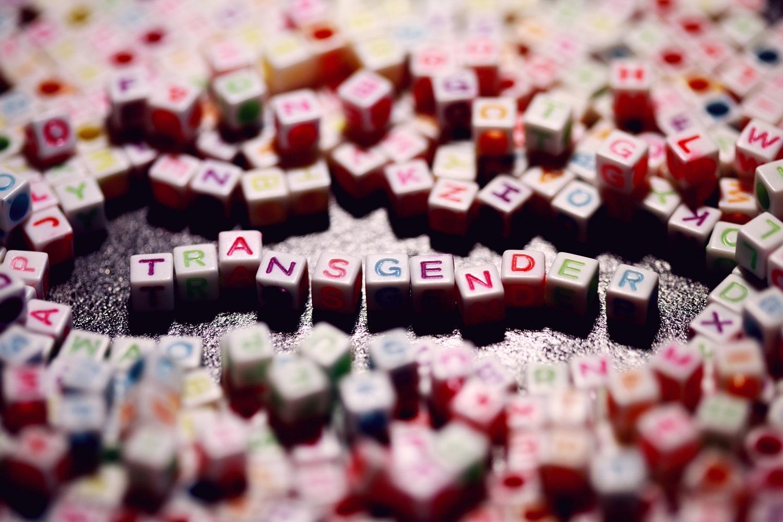 Multi-colored transgender letters for gender identity.