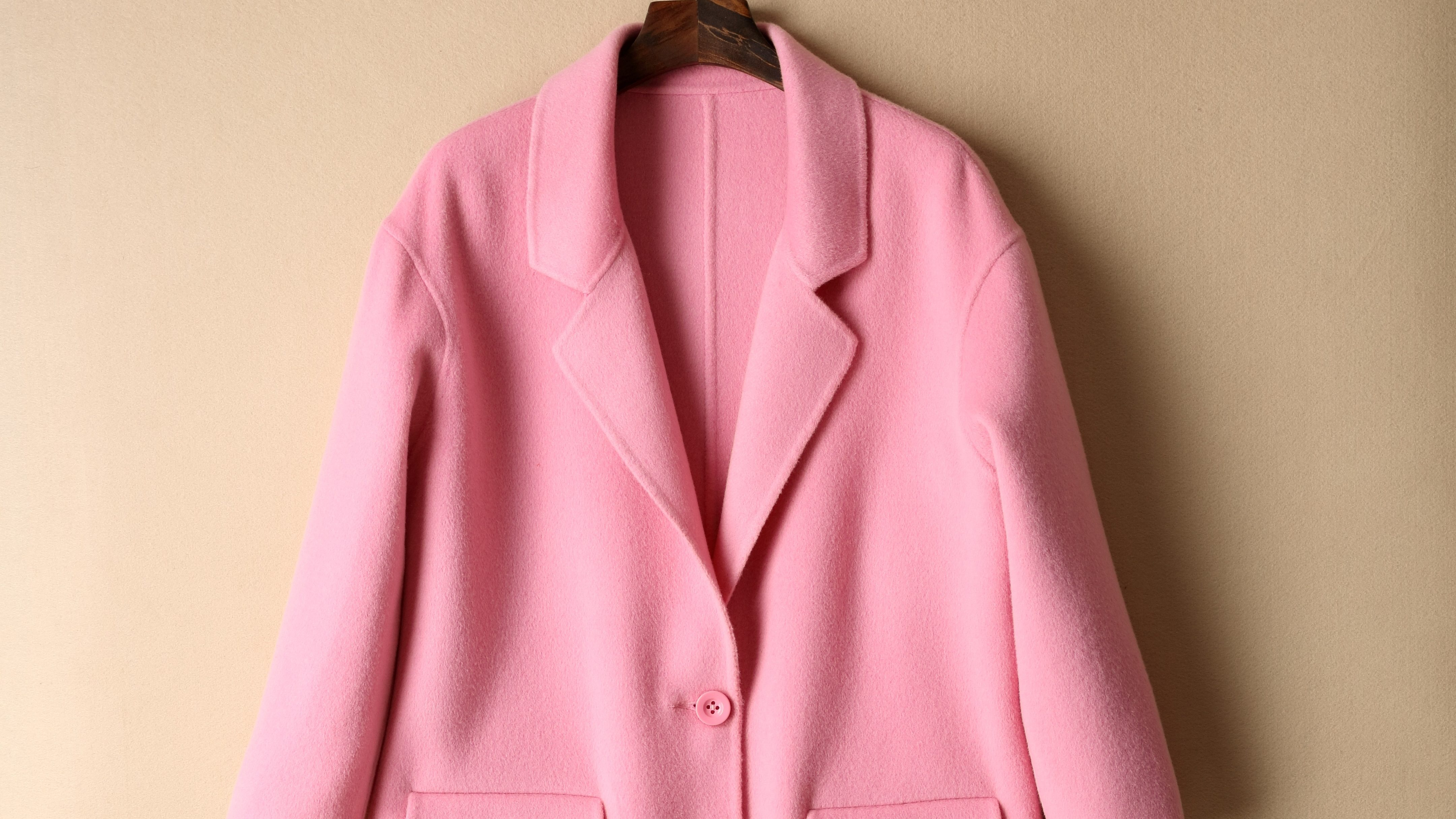 A pink coat on a hanger