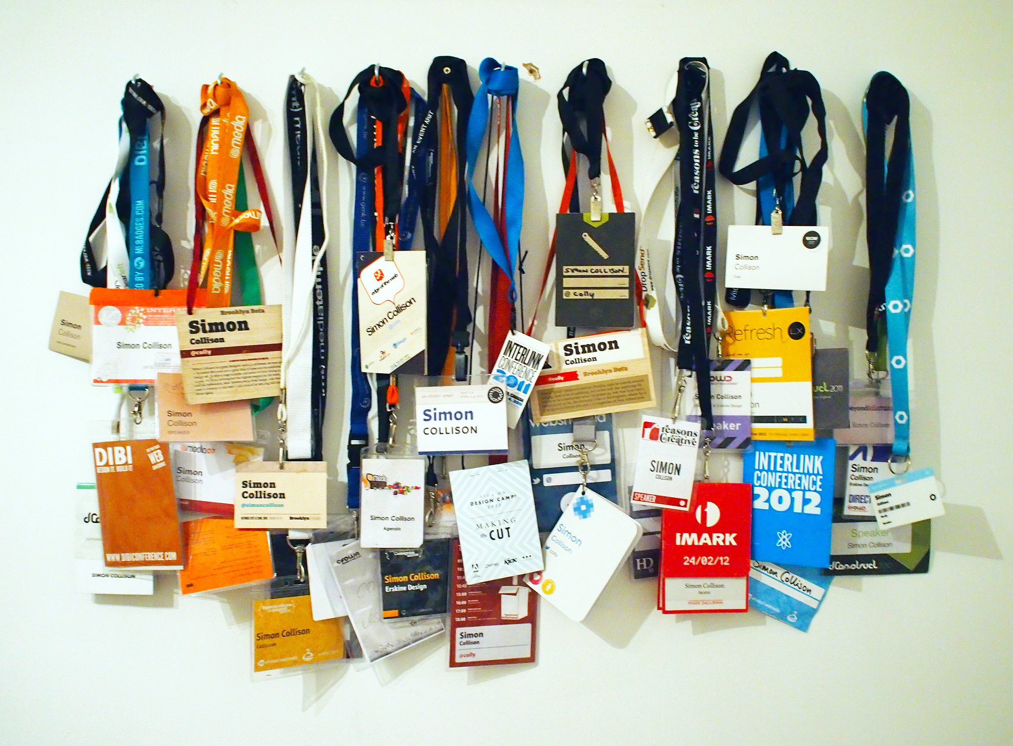 A line up of many of the badges given to conference attendees.