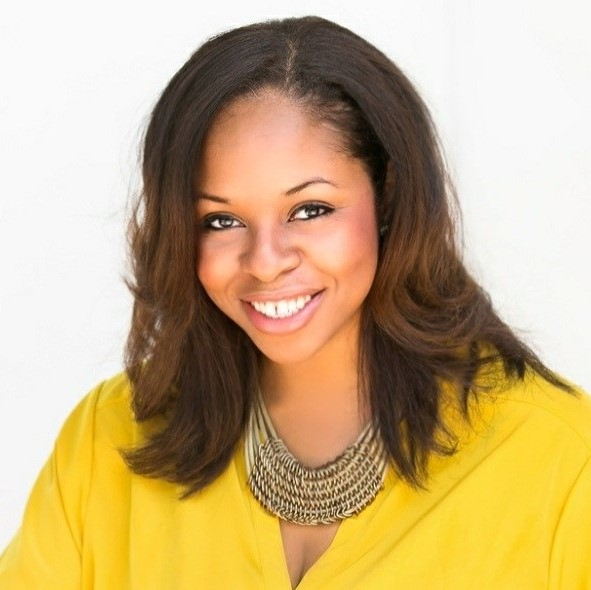 Headshot of Janeen Bryant, a black woman with long dark brown hair wearing a bright yellow top.