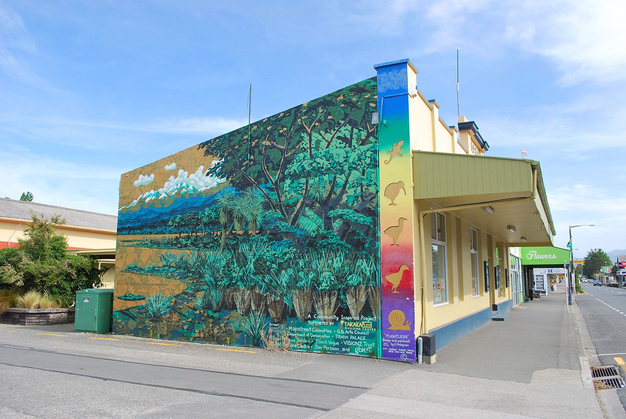 A mural painted on the side of a building.