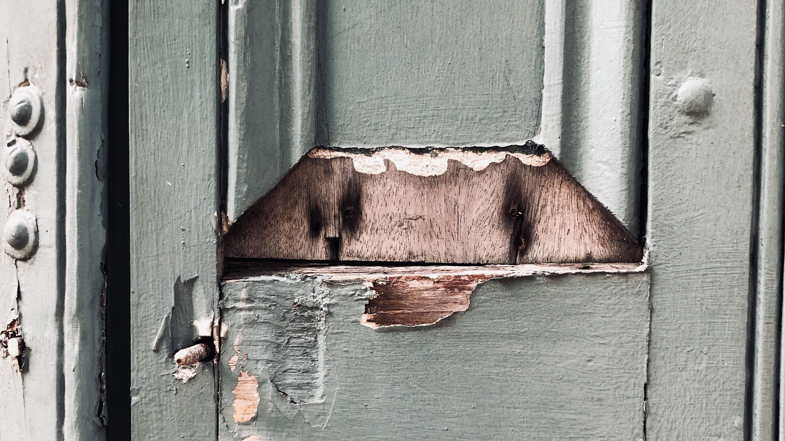 A door with peeling paint