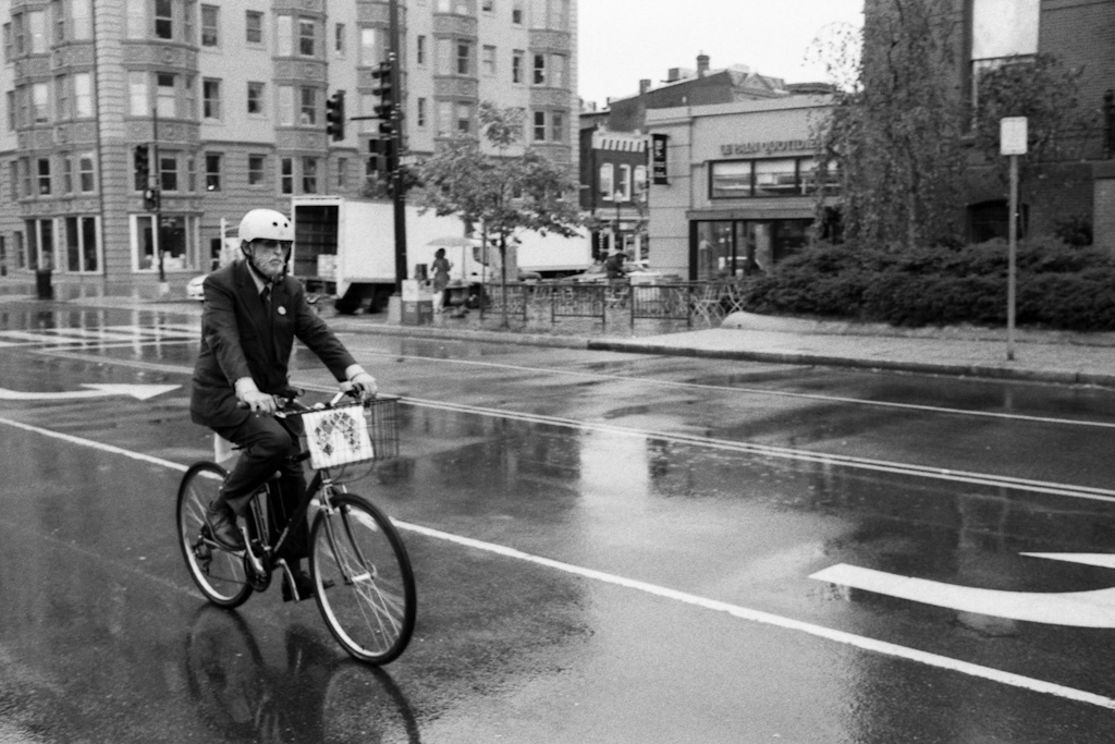 Suited Man on a Bicycle, Dupont Circle, Washington, DC. © 2012 Eric Spiegel