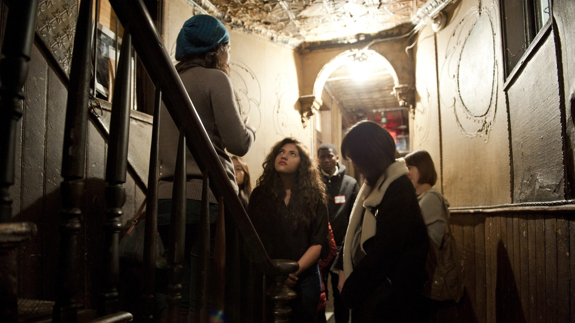 A tour group in a historic tenement at the Tenement Museum