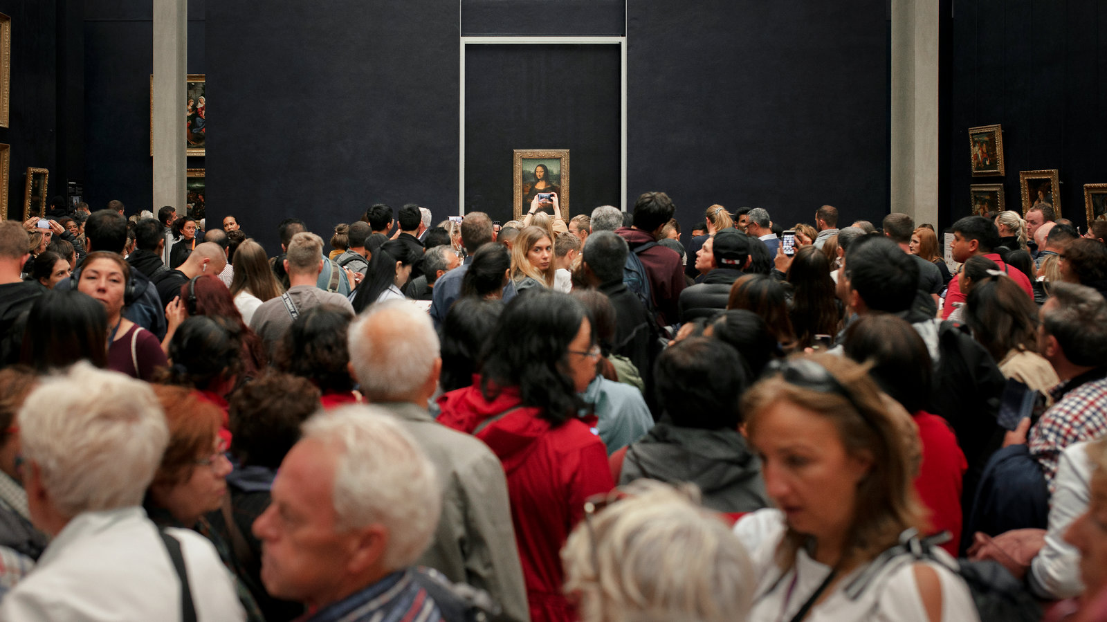 Visitors to the Louvre to see the Mona Lisa on Oct. 24. Each day, 30,000 people pass through the gallery where Leonardo's painting hangs, according to the museum's director.Credit...Elliott Verdier for The New York Times