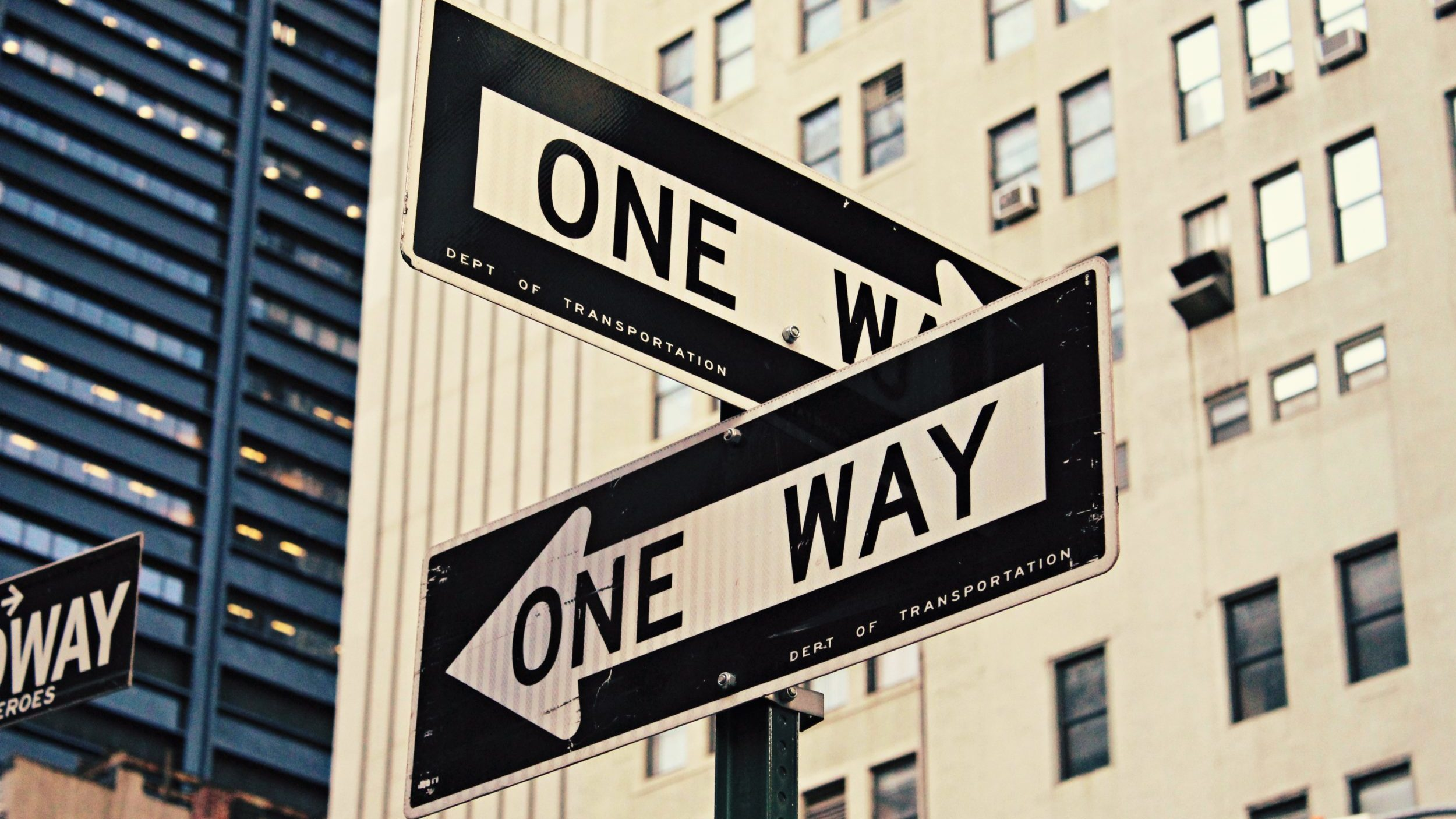 "Intersection ""one way"" road signs."