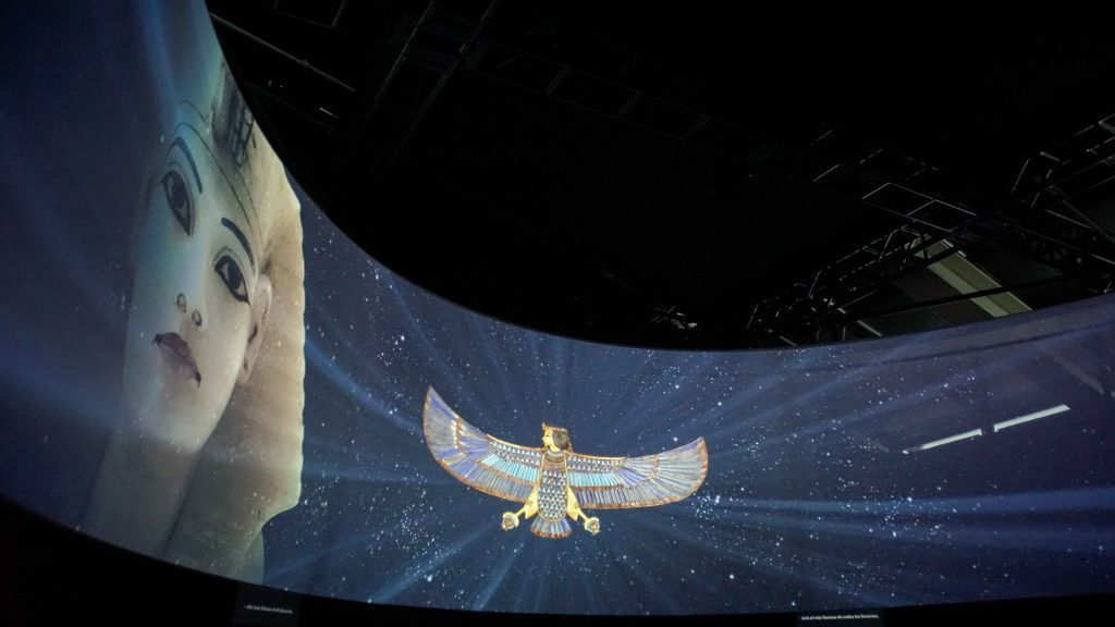 A large wraparound screen with an animated video showing King Tut and artifacts from his tomb