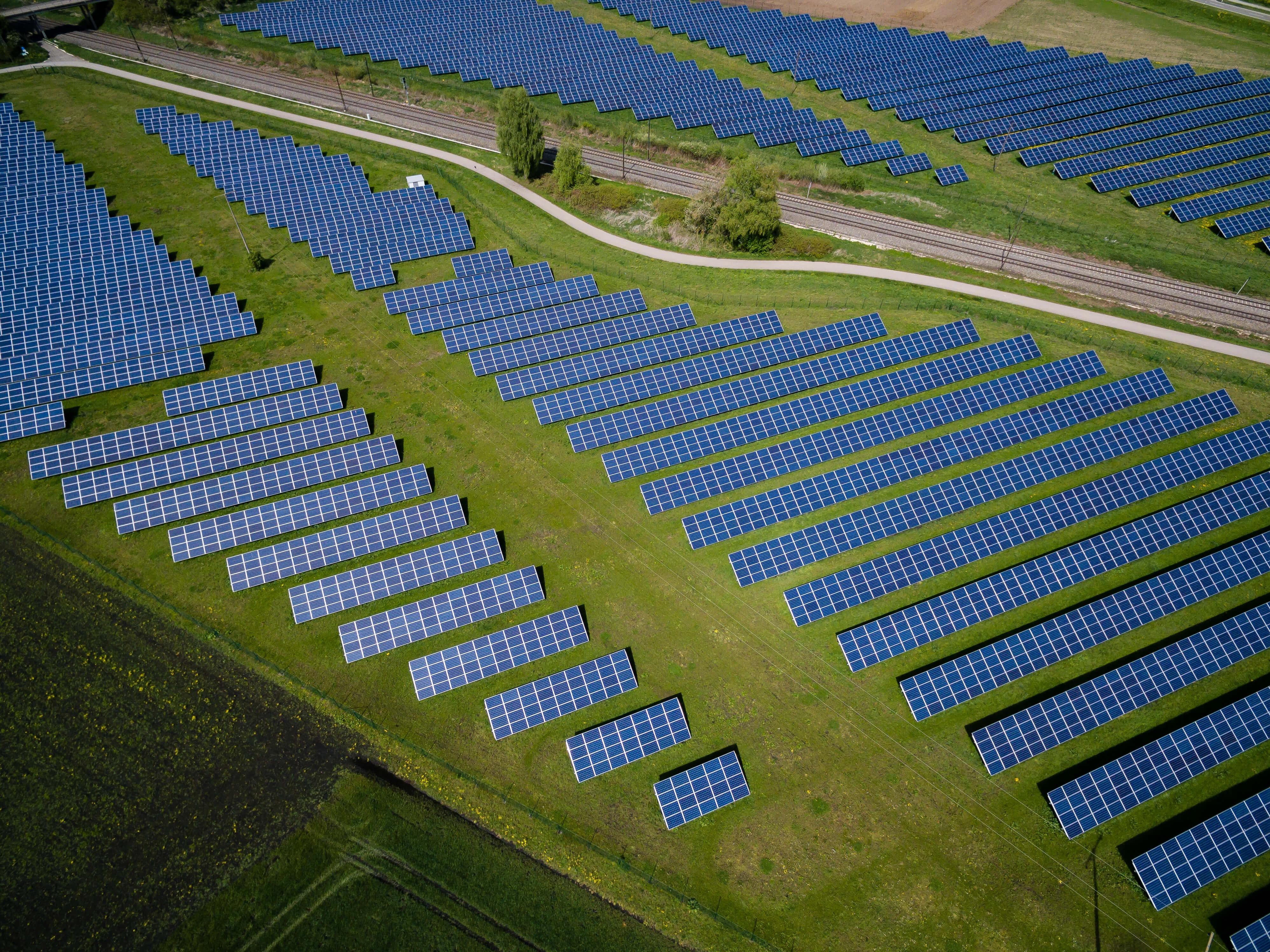 Solar power farm. Photo by Andreas Gücklhorn on Unsplash