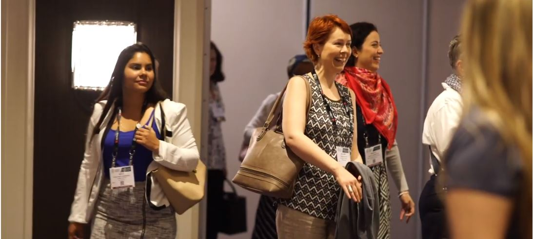 Several attendees at the AAM Annual Meeting and MuseumExpo leaving a room smiling.