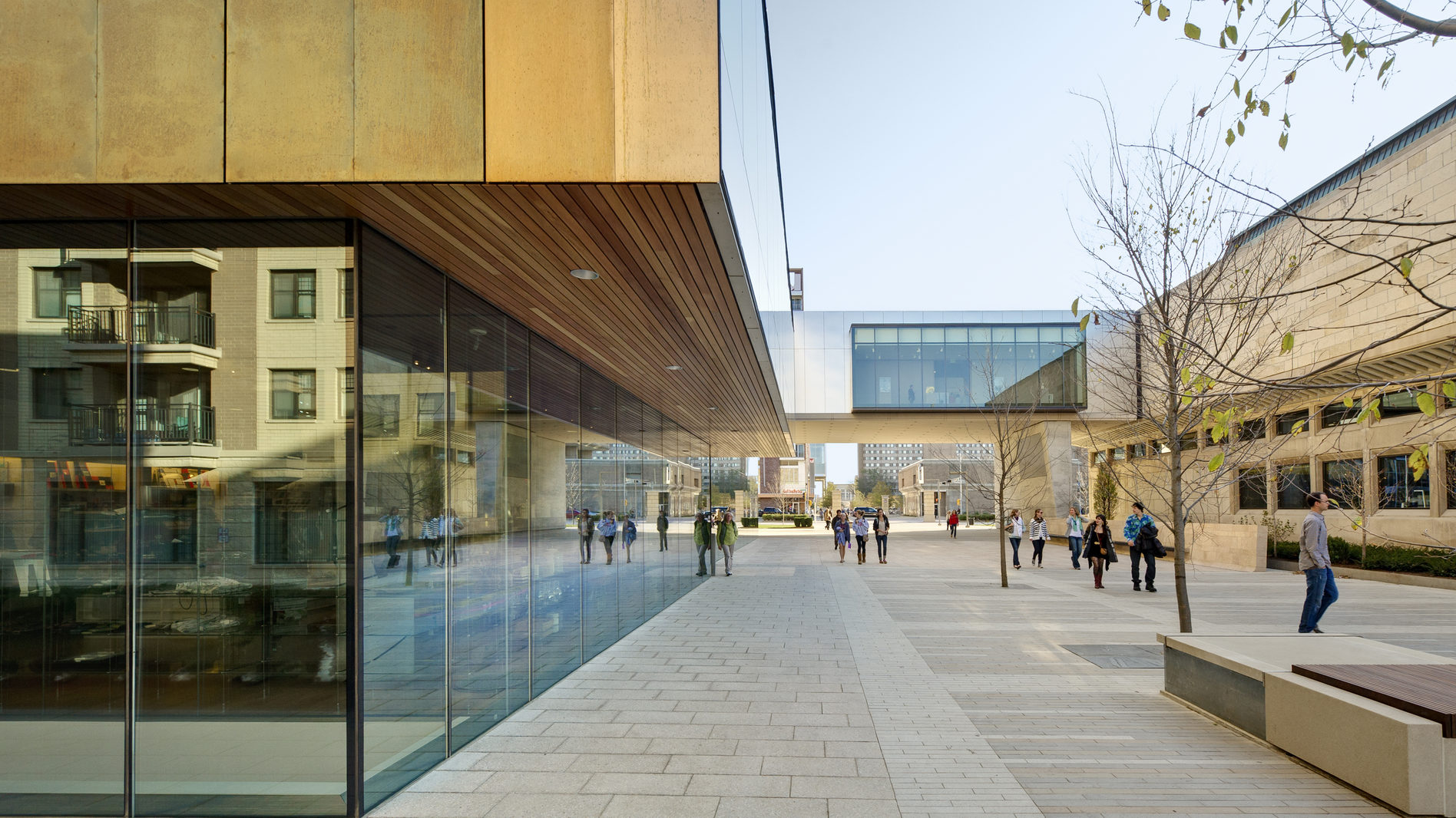 Exterior of a building focused on a walkway, where students are crossing past