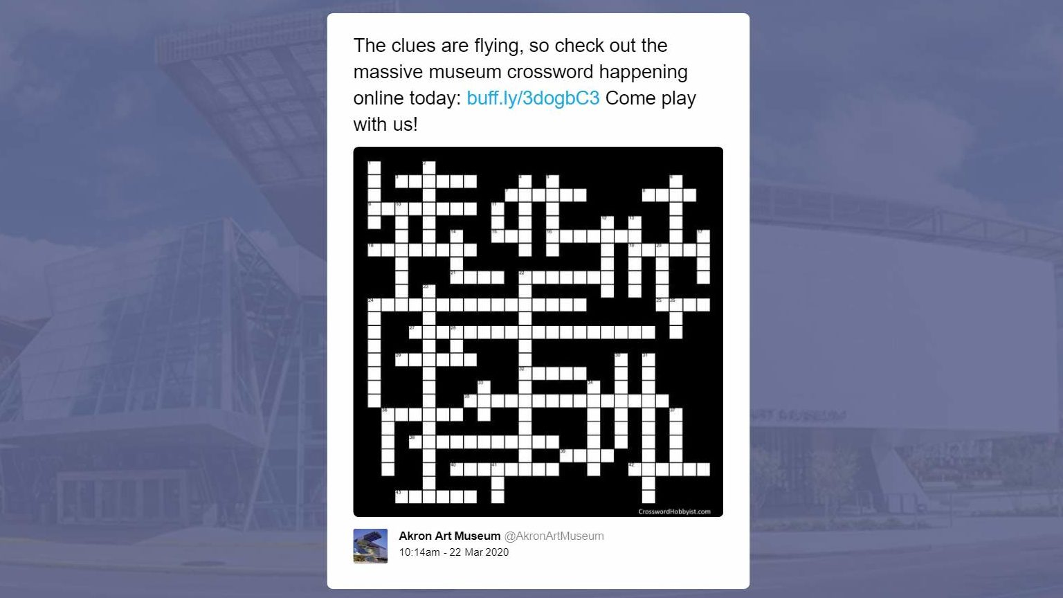 "A tweet reading ""The clues are flying, so check out the massive museum crossword happening online today...Come play with us!"" with an image of an empty crossword puzzle."