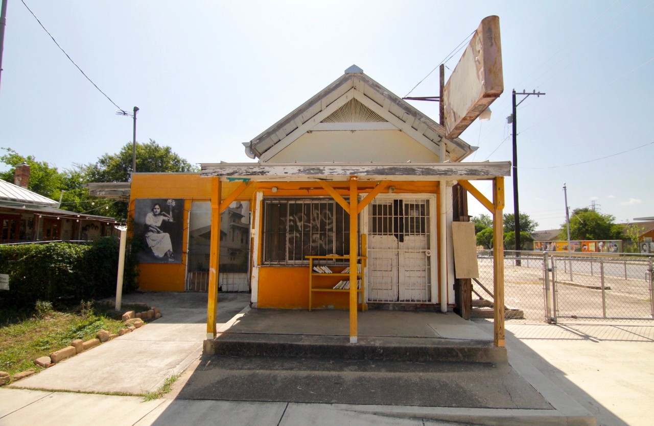 A small yellow-painted storefront