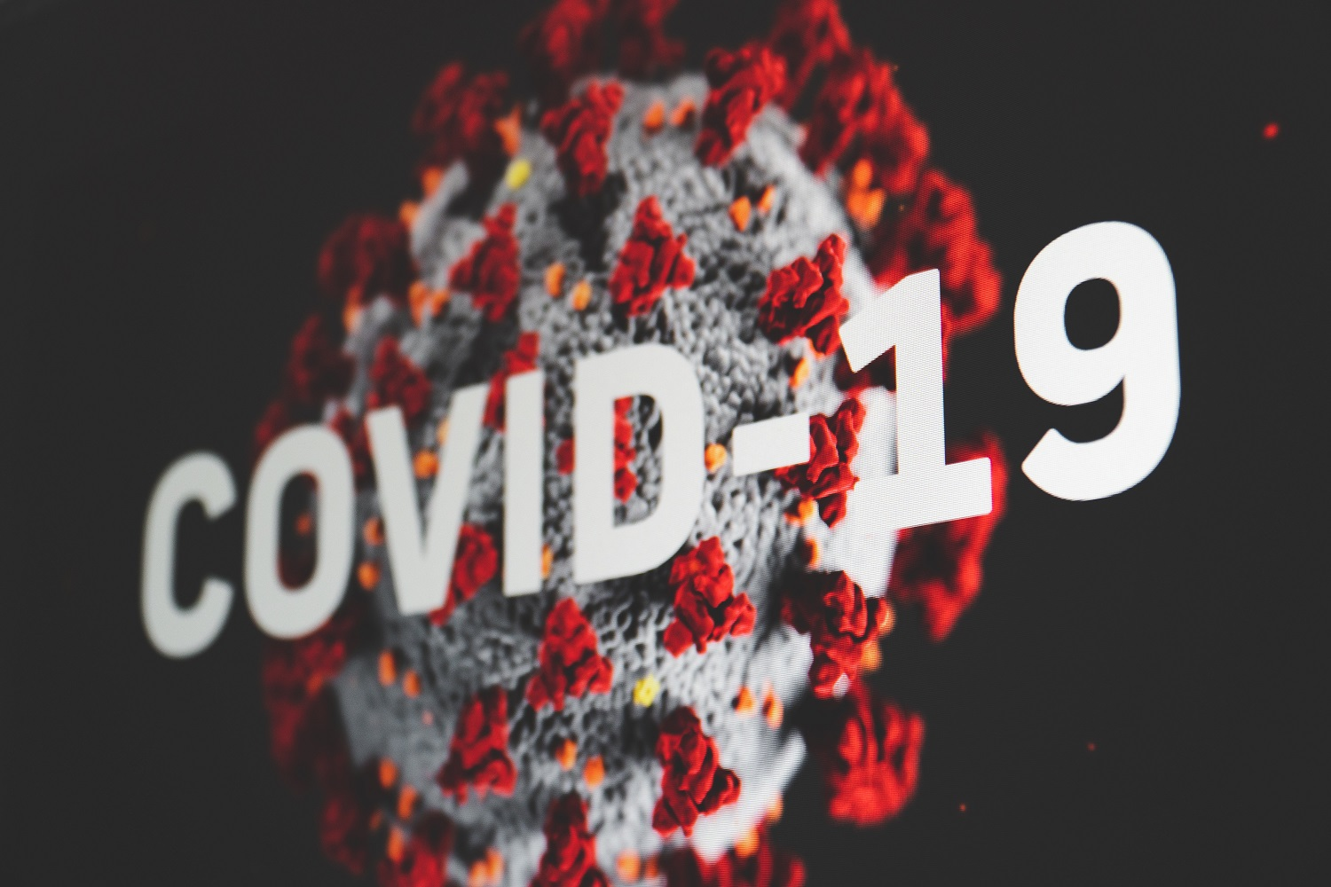 Abstract view of the COVID-19 coronavirus red bloom with white ball.