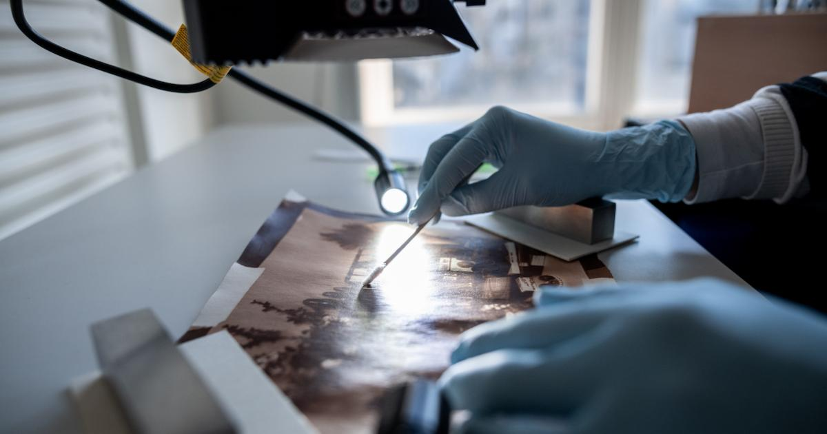 A museum conservator at work. Photo by Fabian Strauch/picture alliance via Getty Images.