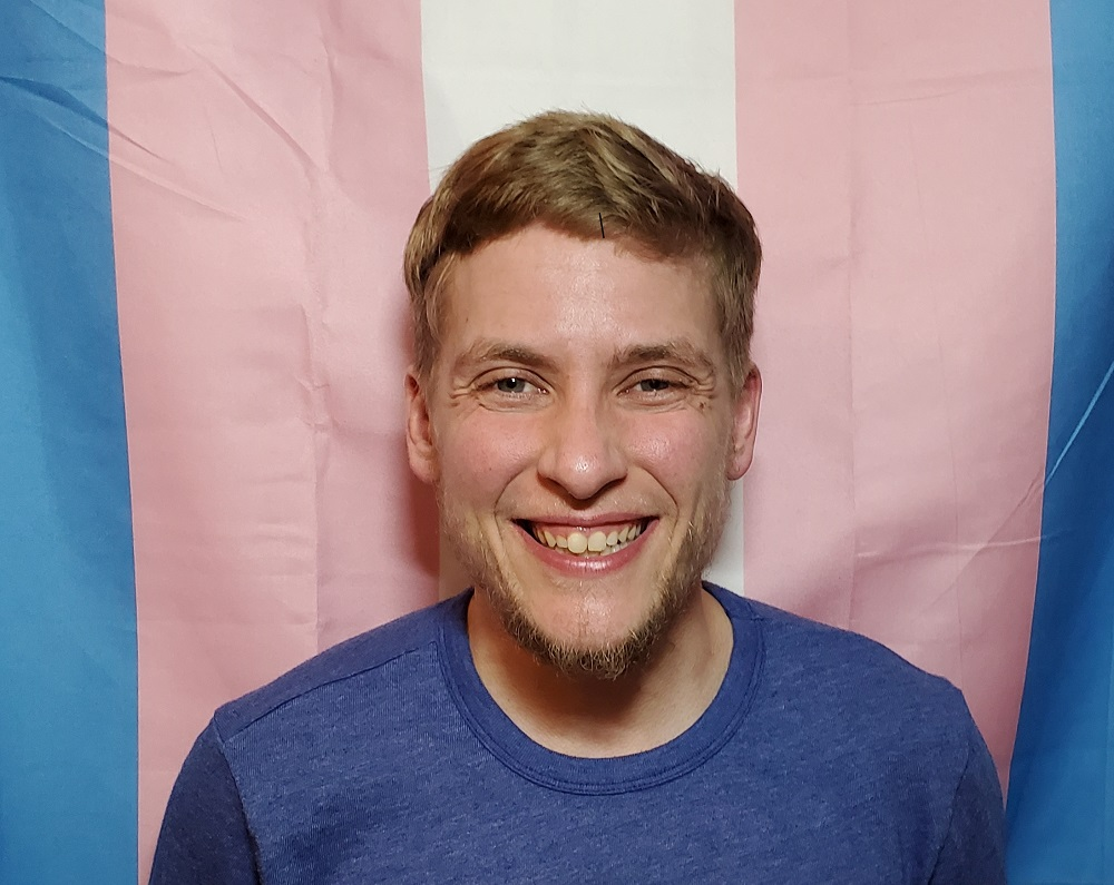 Headshot of Alex Lussenhop.