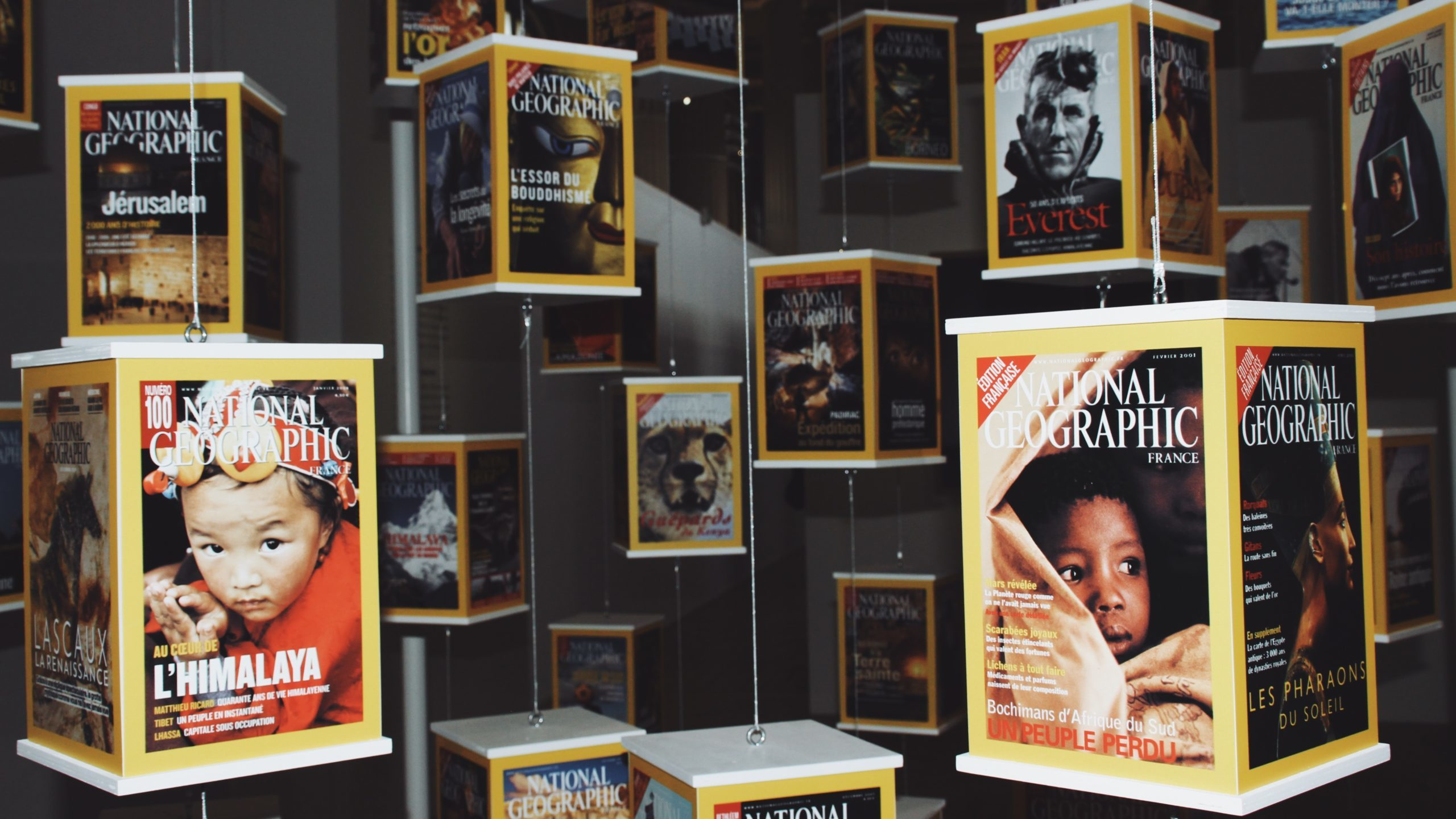 A display of issues of National Geographic magazine in a museum