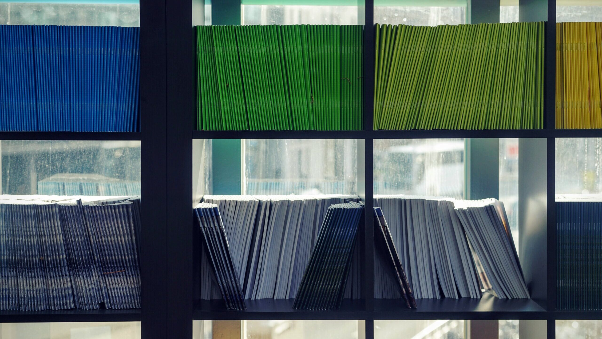 Shelves filled with color-coded document folders