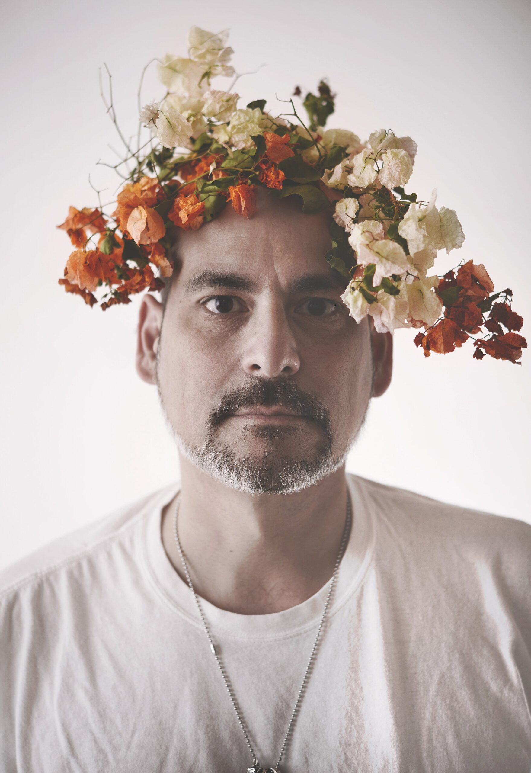 Headshot of Franklin Vagnone, wearing a flower crown