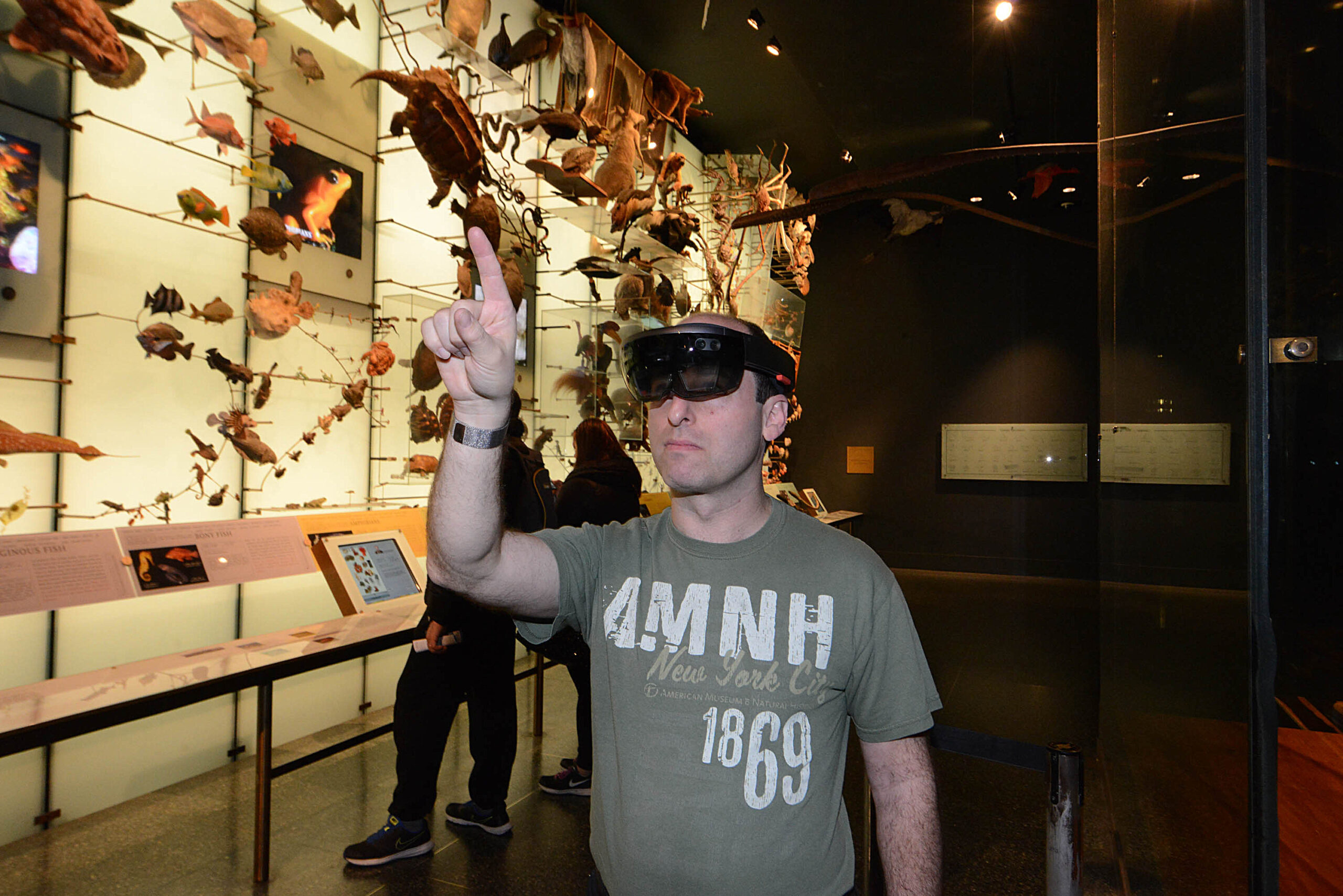 Barry Joseph tests out a new game at the  American Museum of Natural History