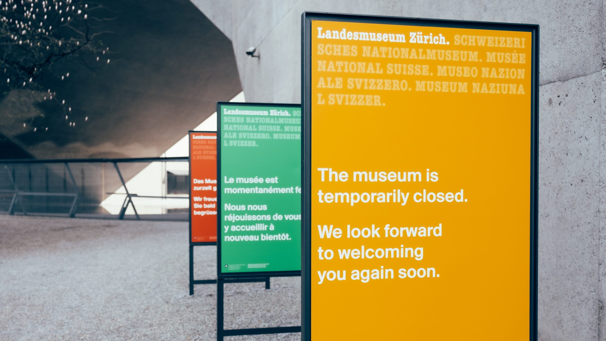 "Signage in a museum reading ""The museum is temporarily closed. We look forward to welcoming you again soon."""