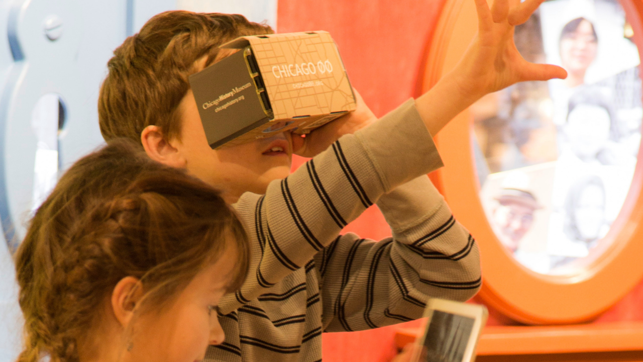 Children using a VR headset and AR app on an iPad inside a museum