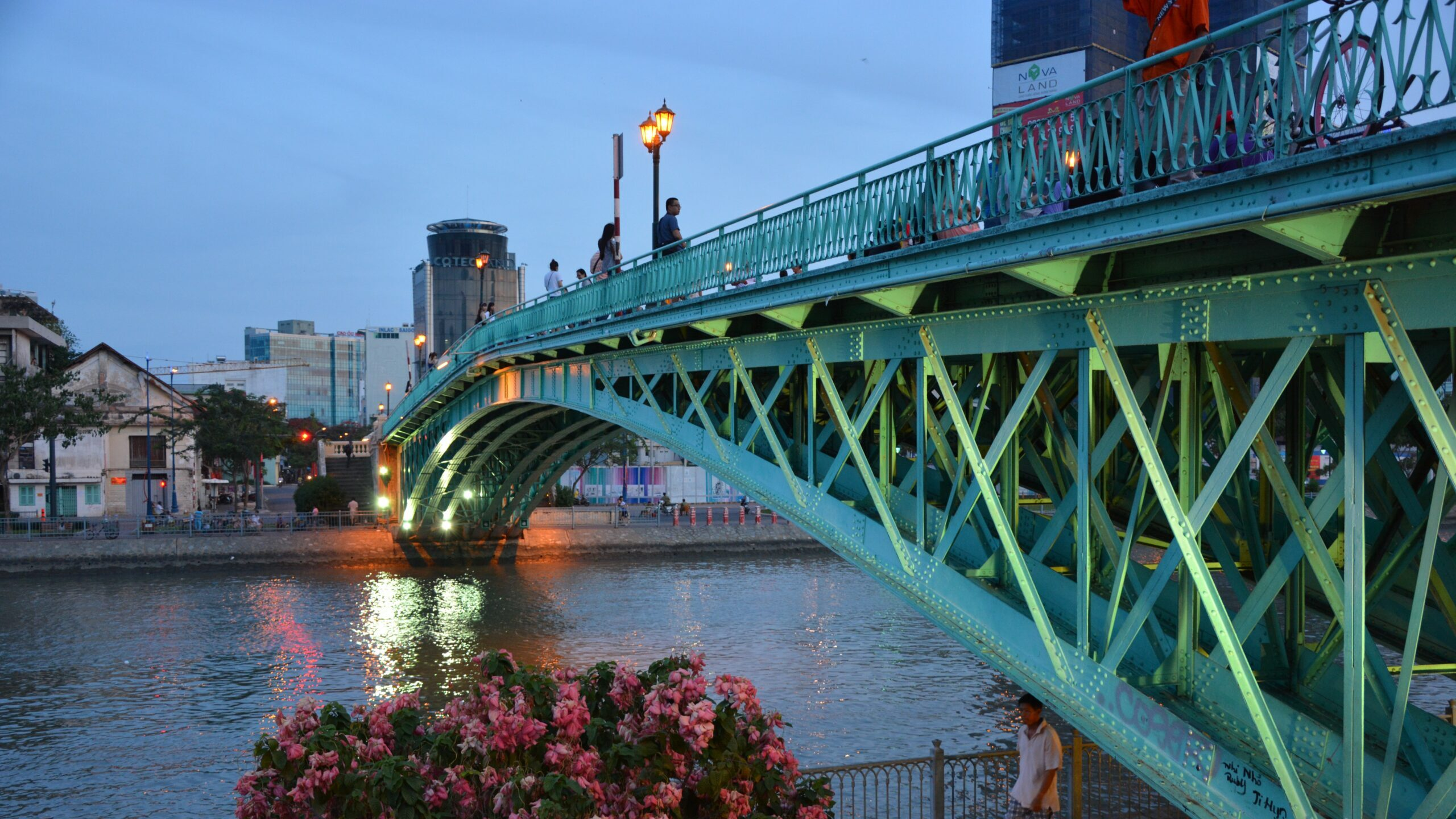 A photo of a bridge over a body of water in a city